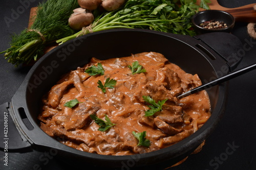 Vászonkép Beef Stroganoff with cremini and champignons on a frying pan.