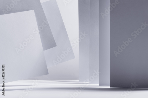 Modern simple geometric white grey abstract scene with stripes, perspective, light, shadow and flying asymmetry construction as border, abstract city, architecture, scene Wallpaper Mural