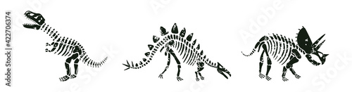 Fényképezés Vector set with dinosaurs skeletons silhouettes in white and black