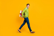 Full Length Body Size Profile Side View Of Nice Funky Cheerful Guy Carrying Hiding Giftbox Isolated On Bright Yellow Color Background