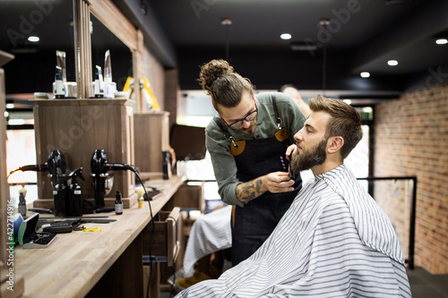 Client during beard shaving in barber shop Fotobehang