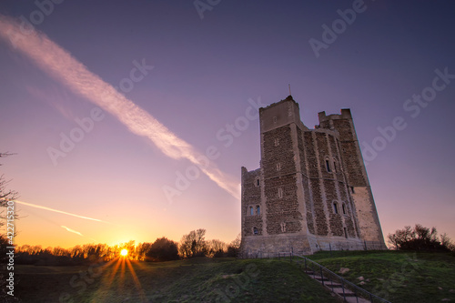 Canvas Print A dramatic sunset over the 12th century Orford Castle in Suffolk, UK