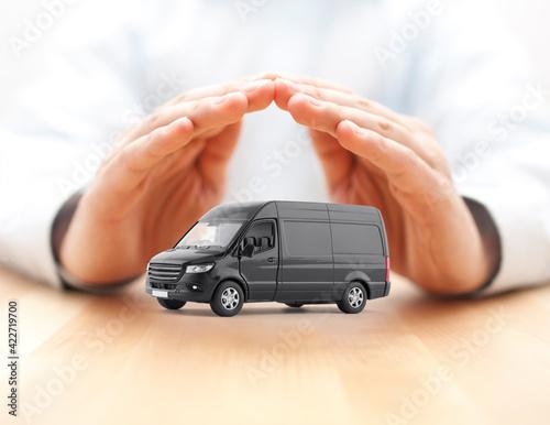 Transport black van car protected by hands