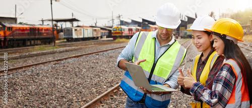 Obraz na plátně Rail logistics engineers are meeting on the train track.