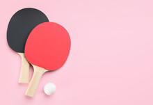 Ping Pong Rackets And Ball On Pink Background, Flat Lay. Space For Text