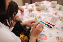 Beautiful Daughter Spend Time With Mom At Home During Qurantine. Cute Little Girl Print On Easter Eggs With Mother. Selebrating Spring Holidays