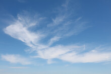 Bright White Clouds Over Blue Sky