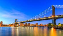 Manhattan Bridge In New York City. Is A Suspension Bridge That Crosses The East River In New York City, Connecting Lower Manhattan With Downtown Brooklyn.
