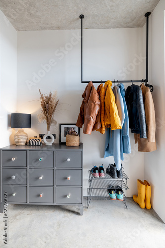 Fotografering House hallway interior with clothes and furniture