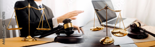 Fototapeta justice and law concept.Male judge in a courtroom on wooden table and Counselor or Male lawyer working in office. Legal law, advice and justice concept. obraz