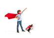Child pretending to be a superhero with his super dog isolated on white studio background