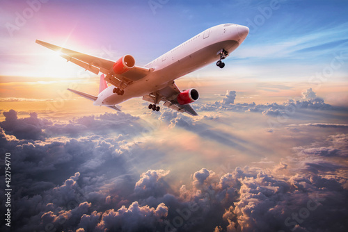 Fototapeta Landscape with aircraft is flying above clouds in the blue sky. Travel background with passenger plane. Commercial airplane. Private jet. Fast Travel and transportation concept obraz