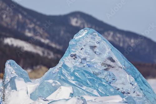 Obraz A large transparent ice floe stands vertically on Lake Baikal - fototapety do salonu