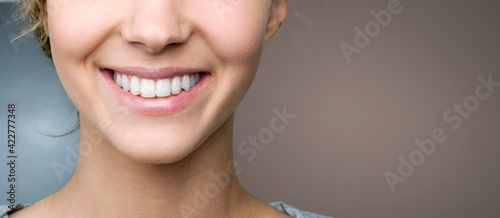 Obraz Beautiful smile of young woman with healthy white teeth - fototapety do salonu