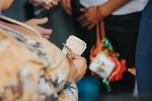 Closeup Shot Of A Woman's Hands Counting Money Collected During The Wedding Ceremony
