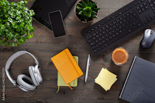 Obraz home office desk with keyboard computer smartphone notebook houseplants, workspace at home - fototapety do salonu