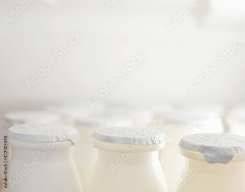 Tableau sur Toile yogurt bottles with vitamin in the fridge