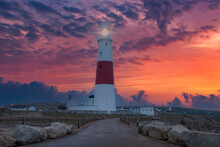 A Dramatic Sunset At The Portland Bill Lighthouse On The South Coast Of England In Dorset