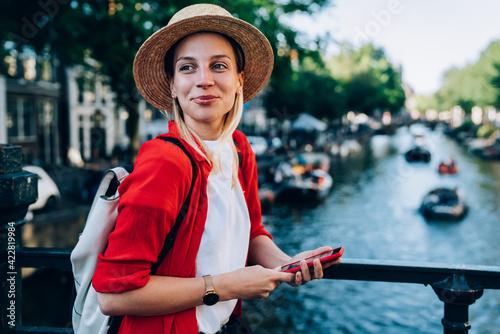 Trendy woman enjoying sightseeing in downtown Wallpaper Mural