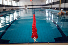Lane Divider In The Pool. Swimming Pool With Clean Water For Athletes Training