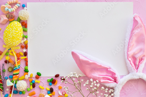 Obraz Easter composition with sweets and bunny ears space for text. Top view, flat lying. - fototapety do salonu
