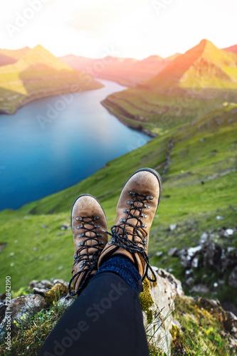 Obraz na plátně Boots of lonely tourist over majestic fjords of Funningur