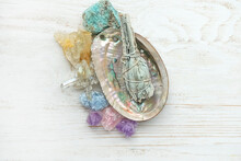 Gemstones Minerals And White Sage Bundle On Abalone Shell. Holy Sage Bunch, Incense For Fumigation. Cleaning And Good Energy. Wiccan Witchcraft. Life Balance, Esoteric Spiritual Practice Concept