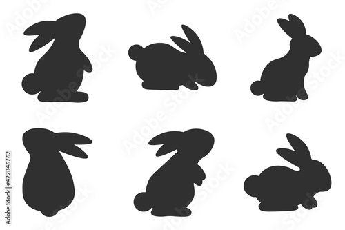 Fototapeta Set of silhouettes of rabbits. Collection of rabbits in various poses. Easter bunny. Vector illustration on a white background. obraz