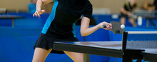 Ping Pong Table, Woman Playing Table Tennis With Racket And Ball In A Sport Hall