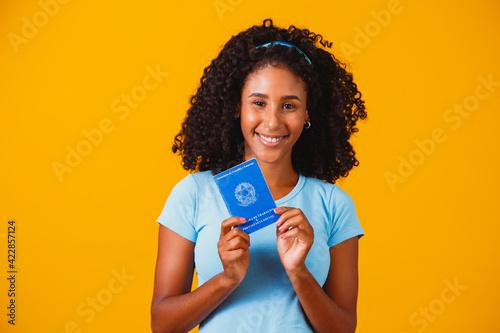 Fotografiet Brazilian woman with document work and social security, (Carteira de Trabalho e