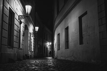 Silhouette Of Person On The Old Streets Of Prague At Night