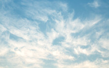The Sky Is Large, Bright, Beautiful And Has White Clouds.