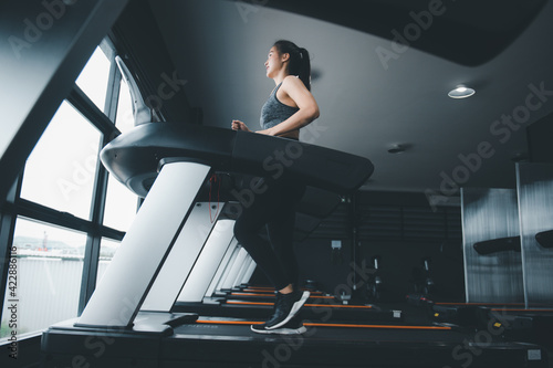 Fotografie, Obraz Asian beautiful sport woman under exercise in treadmill gym make good healthy, bodybuilding in fitness lifestyle