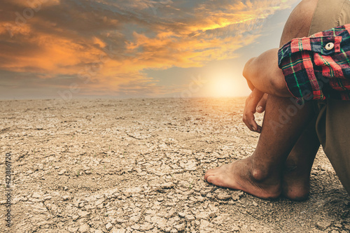 Canvas The little boy waiting for drinking water to live through this drought, Concept drought and crisis environment