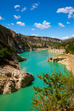 Unique Landscape Of Mont-Rebei Gorge And Noguera Ribagorcana River Between Steep Rocky Cliffs Covered With Greenery, Spain..
