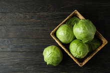 Basket With Fresh Cabbage On Wooden Table