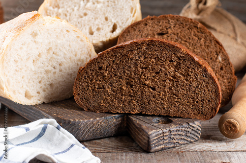 Fototapeta Loaf of bread and rye bread still life on wooden background obraz