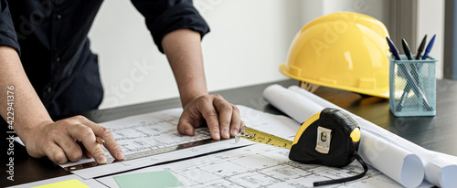 Photo Home design architects are editing the drafts of the house plans, a project that was commissioned by clients and designed according to the requirements prior to delivery