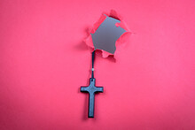 Religion, Belief And Conviction Concept. Wooden Cross On A Red Background