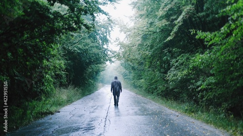 Silhouette Of Sad Man Passing Trough A Misty Forest Path At Dusk Social Distance Hiking Lifestyle