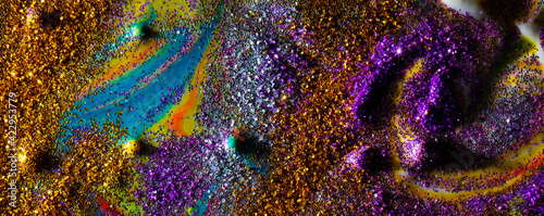 Fotografering Multicolored banner: on a dark background, sprinkled with purple and gold sparkles with streaks and waves