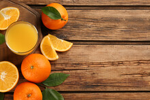 Orange Juice And Fresh Fruits On Wooden Table, Flat Lay. Space For Text
