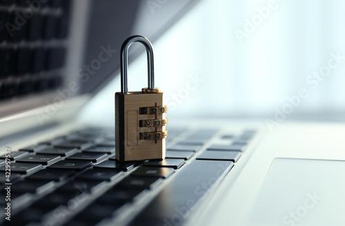 Fototapeta Metal code padlock on laptop keyboard, space for text