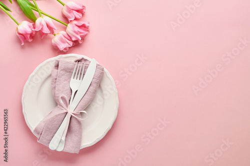 Tela Easter table setting with floral decor on pink table