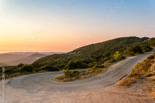 Canvas Winding mountain road curve on Corfu island in Greece at sunset