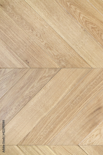 Fototapeta Top view of an french herringbone parquet floor under natural light. Wooden pattern with oak diagonal texture. obraz na płótnie