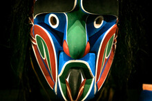 Totem Pole - The Masked Man. Colorful Face