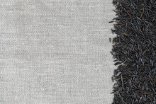 Creative Background With Black Wild Rice On Linen Canvas For Natural Products