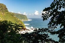Vegetation Covered Hills Descend To The Shore Where The Pacific Ocean Waves Crash Along The Road To Hana, Maui, Hawaii