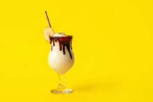 Glass Of Tasty Banana Milkshake On Color Background